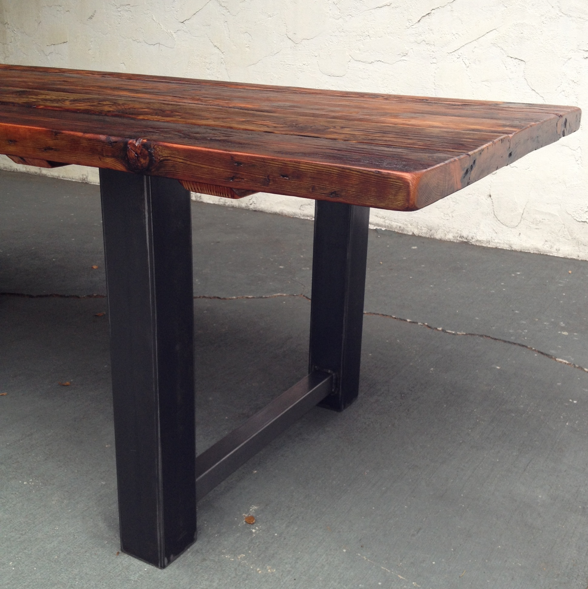 Reclaimed Wood and Metal Dining Table 5. Reclaimed Wood and Steel Dining Table   The Coastal Craftsman