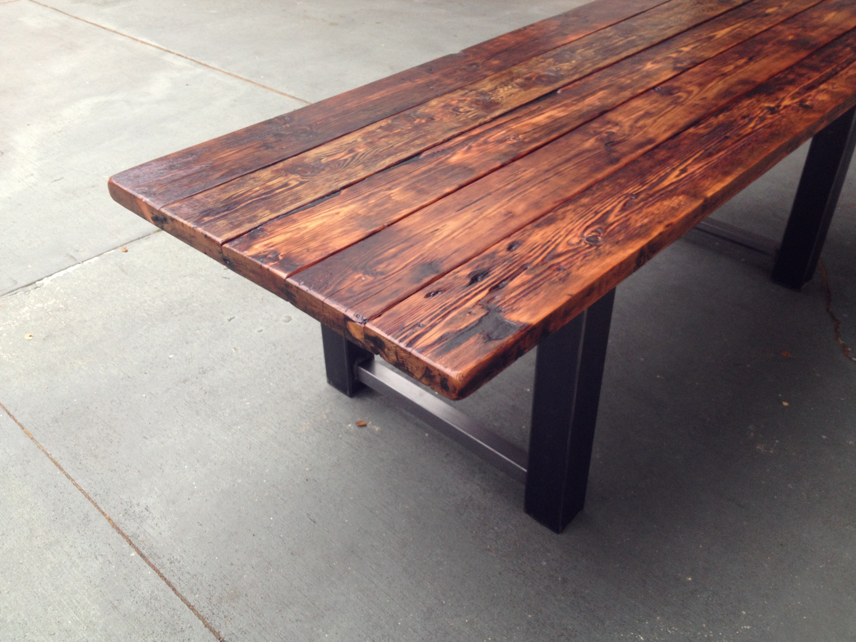 Reclaimed Wood and Metal Dining Table 8. Reclaimed Wood and Steel Dining Table   The Coastal Craftsman