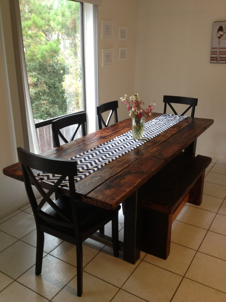 This bench is a great way to save space in a small dining room.