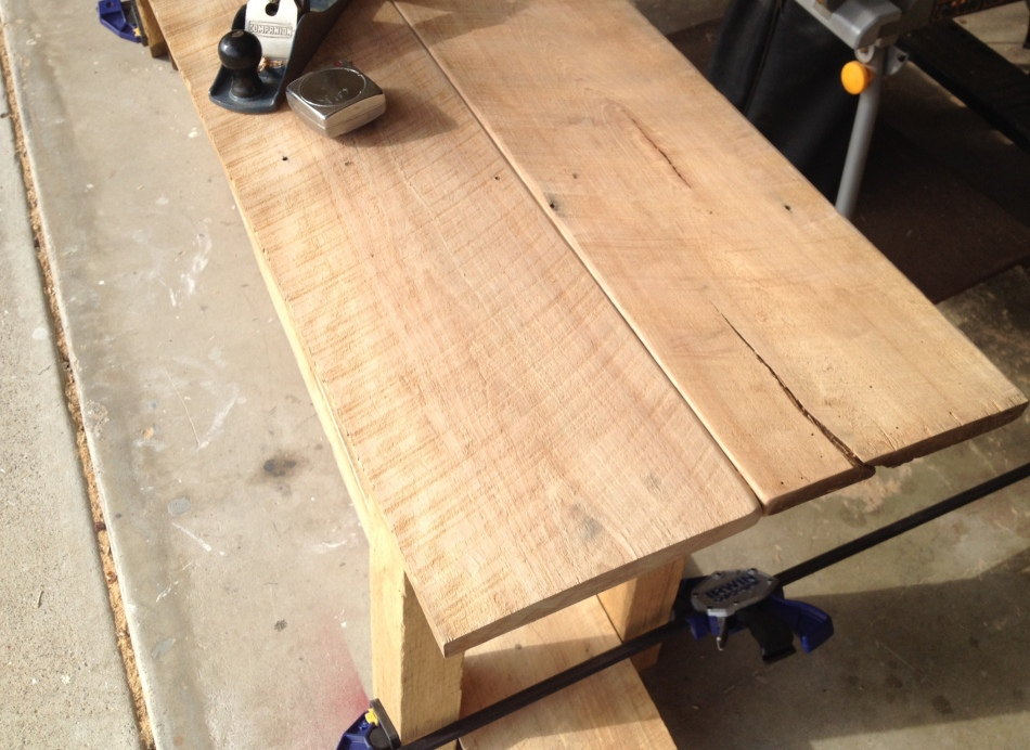 Beech reclaimed from a 138 year old barn forms the two shelves on this 7' long table.