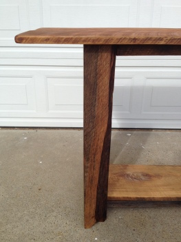 Partial live edge on the leg of this long barn wood table. www.thecoastalcraftsman.com