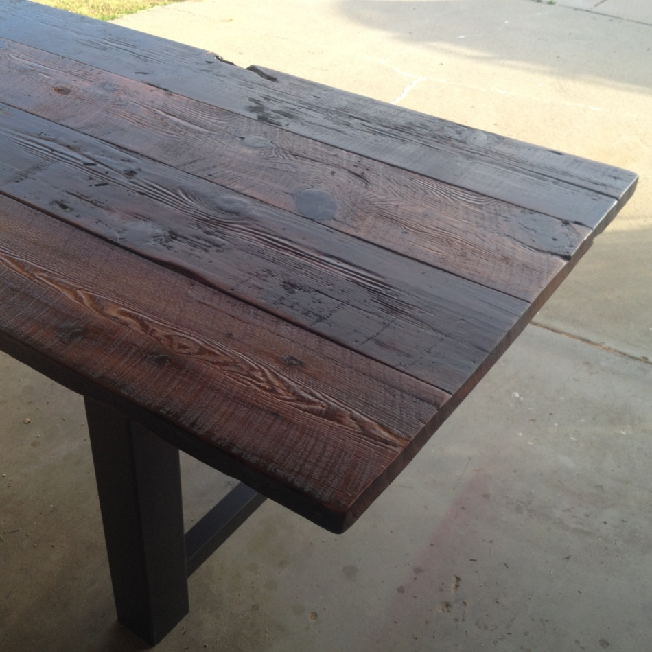 Reclaimed Fir is combined with solid steel legs to create a modern outdoor dining table.