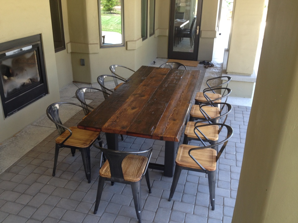 "This Reclaimed Wood and Steel Outdoor Dining Table was custom built to 95""x40""x30"".  Designed and built to seat 10 people, it is constructed out of Douglas Fir reclaimed from a Wisconsin barn."