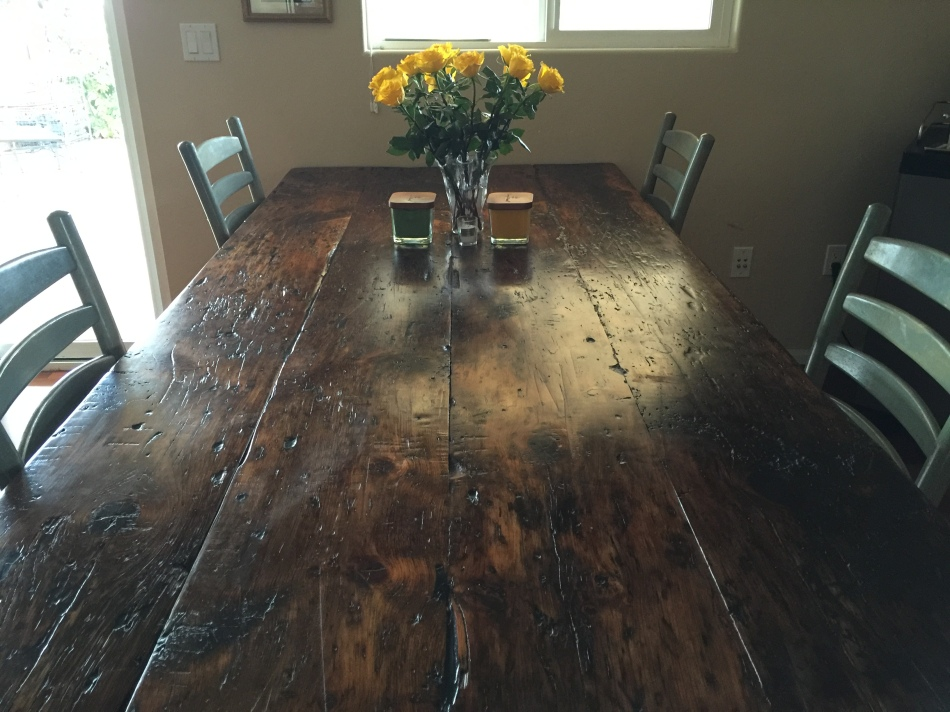 Reclaimed Pine from a Wisconsin Barn is combined with Steel bases to make this Dining Table with great character.  www.thecoastalcraftsman.com